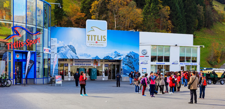 Engelberg, Switzerland - 12 October, 2015: people at the entrance to the cable car station at the foot of Mt. Titlis. Engelberg is a resort town and municipality in the Swiss canton of Obwalden, the Titlis is a mountain located on the border between the S