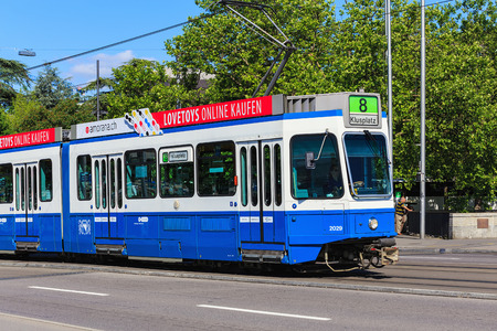 Zurich, Switzerland - 18 June, 2017: a tram passing along General Guisan quay in the city of Zurich. Trams make an important contribution to public transport of the city, they have been a consistent part of Zurichs cityscape since the 1880s, electrified