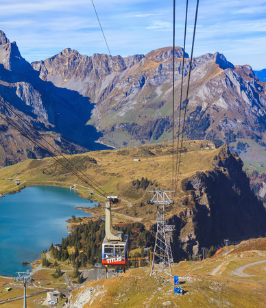 Mt. Titlis, Switzerland - 12 October, 2015: a gondola of a cable car on Mt. Titlis. The Titlis is a mountain located on the border between the Swiss cantons of Obwalden and Bern, it is mainly accessed from the town of Engelberg.