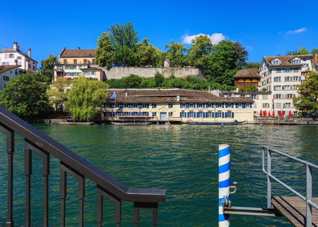 Zurich, Switzerland - 18 June, 2017: buildings of the Schipfe district in the city of Zurich, view from a pier on the Limmat river. The Schipfe is one of the oldest parts of the city of Zurich, which is the largest city in Switzerland and the capital of t Editorial