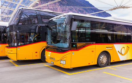 Chur, Switzerland - 3 March, 2017: Post Buses at the Chur bus station. Post Bus Switzerland (German: PostAuto Schweiz) is a subsidiary company of the Swiss Post, it provides regional and rural bus services throughout Switzerland and also in France and Lie
