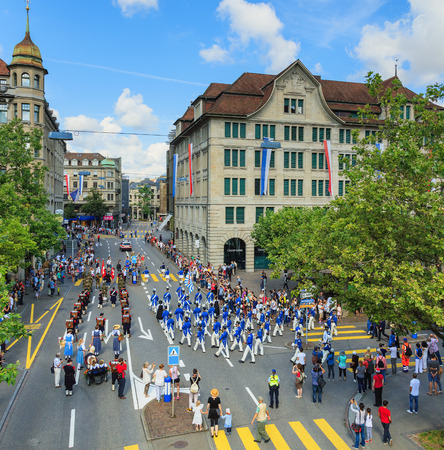 Zurich, Switzerland - 1 August, 2016: participants of the parade devoted to the Swiss National Day passing along Uraniastrasse street. The Swiss National Day is the national holiday of Switzerland, celebrated on 1 August. Editorial