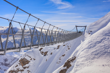 Suspension bridge on Mt. Titlis in wintertime. The Titlis is a mountain located on the border between the Swiss cantons of Obwalden and Bern, mainly accessed from the town of Engelberg on its northern side.