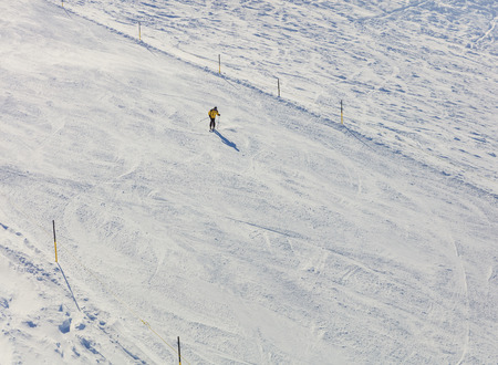 Mt. Titlis, Switzerland - 9 March, 2016: a person skiing on Mt. Titlis. The Titlis is a mountain located on the border between the Swiss cantons of Obwalden and Bern, mainly accessed from the town of Engelberg on the northern side.