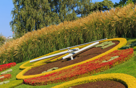 Geneva, Switzerland - 24 September, 2016: the flower clock (French: Lhorloge fleurie) on the western side of Jardin Anglais park  in the city of Geneva. The clock was created in 1955 as a symbol of the citys watchmakers and a dedication to nature Editorial