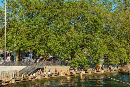 Zurich, Switzerland - 20 July, 2016: people on the embankment of Lake Zurich in the city of Zurich. Zurich is the largest city in Switzerland and the capital of the Swiss canton of Zurich, Lake Zurich is a lake extending southeast of the city of Zurich. Editorial