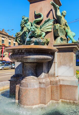 Zurich, Switzerland - 20 July, 2016: the fountain at the basement of the monument to Alfred Escher on Bahnhofplatz square in Zurich, Switzerland. Alfred Escher was a renowned Zurich politician, businessman and railway pioneer, Swiss sculptor Richard Kissl