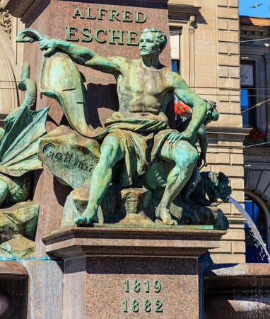Zurich, Switzerland - 20 July, 2016: the fountain at the basement of the monument to Alfred Escher on Bahnhofplatz square in Zurich, Switzerland. Alfred Escher was a renowned Zurich politician, businessman and railway pioneer, the monument was created in