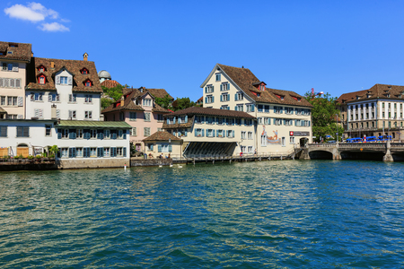 Zurich, Switzerland - 18 June, 2017: the Limmat river and citys old town buildings along it. Zurich is the largest city in Switzerland and the capital of the Swiss canton of Zurich. Editorial