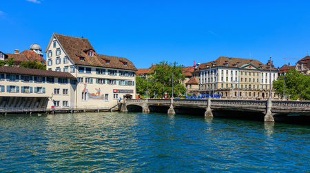 Zurich, Switzerland - 18 June, 2017: the Limmat river, citys old town buildings along it, Rudolf Brun bridge over the river. Zurich is the largest city in Switzerland and the capital of the Swiss canton of Zurich. Editorial