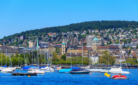 Zurich, Switzerland - 26 May, 2016: boats on Lake Zurich, buildings of the city of Zurich in the background. Lake Zurich is a lake in Switzerland, extending southeast of the city of Zurich, which is the largest city in Switzerland and the capital of the S