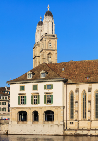 Partial view of the building of the Water Church at the Limmat river in the city of Zurich, Switzerland, towers of the Grossmunster cathedral in the background.