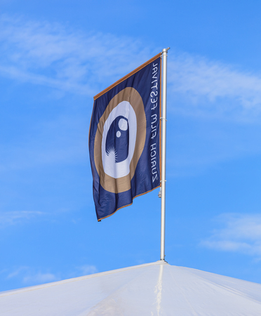 Zurich, Switzerland - 29 September, 2017: flag of Zurich Film Festival on the top of the main tent of festivals venue on Sechselautenplatz square. Zurich Film Festival takes place yearly at the end of September since 2005, in 2017 it lasts from 28 Septem Editorial