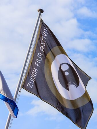 Zurich, Switzerland - 29 September, 2017: flag of Zurich Film Festival at festivals venue on Sechselautenplatz square. Zurich Film Festival takes place annually at the end of September since 2005, in 2017 it lasts from 28 September till 8 October.