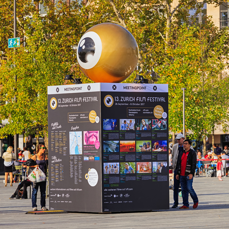 Zurich, Switzerland - 29 September, 2017: people at the meeting point of the Zurich Film Festival on Sechselautenplatz square. Zurich Film Festival takes place annually at the end of September since 2005, in 2017 it lasts from 28 September till 8 October.