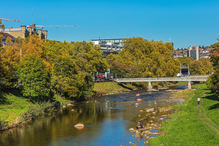 Zurich, Switzerland - 11 October, 2017: view along the Sihl river. The Sihl is a river that rises near the Druesberg mountain in the Swiss canton of Schwyz and eventually flows into the Limmat in the center of the city of Zurich.