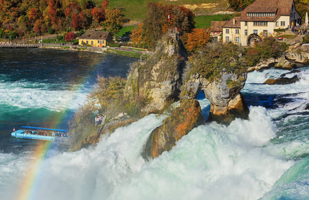Laufen, Switzerland - 17 October, 2017: a rainbow over the Rhine Falls, view from the Laufen castle. The Rhine Falls is the largest waterfall in Europe, located on the border between the Swiss cantons of Zurich and Schaffhausen.