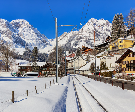 Engelberg, Switzerland - 9 March, 2016: a railway and street in the town of Engelberg. Engelberg is a resort town and municipality in the Swiss canton of Obwalden. Editorial