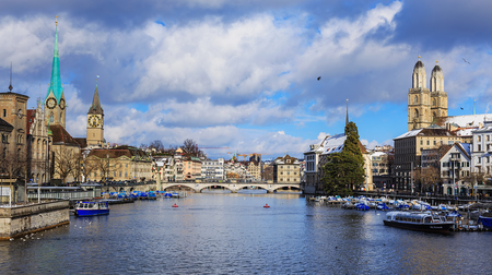 Zurich, Switzerland - 1 February, 2015: view along the Limmat river from the Quaibrucke bridge towards the Munsterbrucke bridge. Zurich is the largest city in Switzerland and the capital of the Swiss canton of Zurich. Redakční