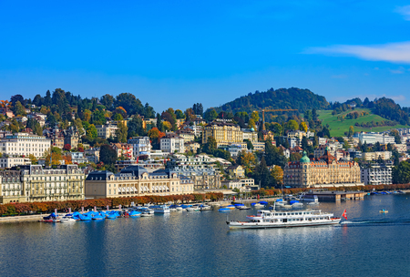 Lucerne, Switzerland - 3 October, 2015: buildings of the city of Lucerne along Lake Lucerne, MS. Gotthard approaching the city. Lucerne is a city in central Switzerland, it is the capital of the Swiss canton of Lucerne and the capital of the district of t Sajtókép