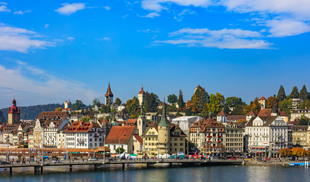 Lucerne, Switzerland - 3 October, 2015: buildings of the city of Lucerne along Lake Lucerne and the Reuss river. Lucerne is a city in central Switzerland, it is the capital of the Swiss canton of Lucerne and the capital of the district of the same name.