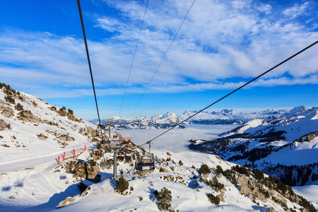 Mt. Fronalpstock, Switzerland - 24 January, 2017: overhead cable car on the Fronalptsock mountain in winter. The Fronalpstock is a mountain in the Swiss canton of Schwyz, it has an elevation of 1,921 meters above sea levell, the summit of the mountain is