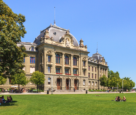 Bern, Switzerland - 11 June, 2014: the main building of the University of Bern, people on the lawn in front of it. The University of Bern is a university in the Swiss city of Bern, founded in 1834.
