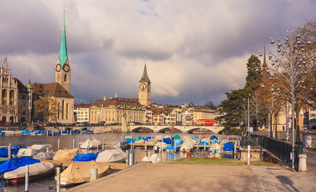 Zurich, Switzerland - 26 November, 2013: the Limmat river, towers of the Fraumunster cathedral and St. Peter church. Zurich is the largest city in Switzerland and the capital of the Swiss canton of Zurich.