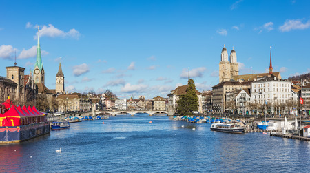 Zurich, Switzerland - 1 January, 2018: view along the Limmat river, towers of the Fraumunster and Grossmunster cathedrals. Zurich is the largest city in Switzerland and the capital of the Swiss canton of Zurich. Editorial