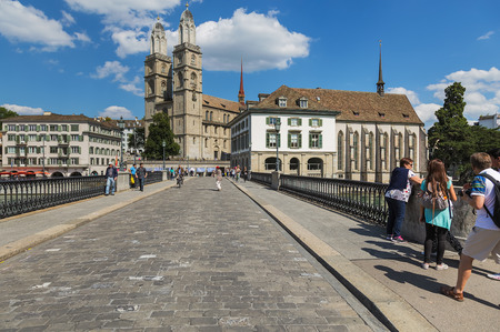 Zurich, Switzerland - 30 July, 2015: view along Munsterbrucke bridge in the city of Zurich. Munsterbrucke is a pedestrian and road bridge over the Limmat river, listed in the Swiss inventory of cultural property of national and regional significance.