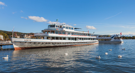 Zurich, Switzerland - 13 October, 2013: MS Linth at a pier on Lake Zurich. MS Linth belongs to the Lake Zurich Navigation Company, which is a Swiss public company operating passenger ships and boats on Lake Zurich.