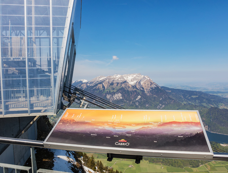 Mt. Stanserhorn, Switzerland - 7 May, 2016: view from the top of Mt. Stanserhorn - the station of the CabriO overhread cable car, summit of Mt Pilatus in the background. The Stanserhorn is a mountain, located in the Swiss canton of Nidwalden close to its