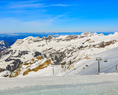 A wintertime view from Mt. Titlis in Switzerland. The Titlis is a mountain located on the border between the Swiss cantons of Obwalden and Bern, mainly accessed from the town of Engelberg on its northern side. Banco de Imagens