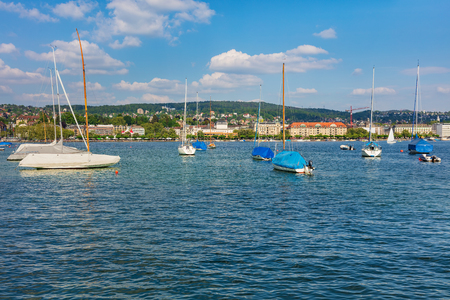 Lake Zurich, buildings of the city of Zurich in the background. Lake Zurich is a lake in Switzerland, extending southeast of the city of Zurich, which is the largest city in the country and the capital of the Swiss canton of Zurich.