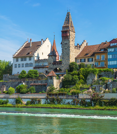 Bremgarten, Switzerland - June 16, 2018: buildings of the historic part of the town along the Reuss river. Bremgarten is a municipality in the Swiss canton of Aargau, its medieval old town is listed as a heritage site of national significance.