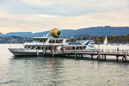 Zurich, Switzerland - September 28, 2017: MS Albis bearing an emblem of Zurich Film Festival at a pier on Lake Zurich at dusk. Zurich Film Festival takes place yearly at the end of September since 2005, in 2017 it lasted from 28 September till 8 October.  Editorial