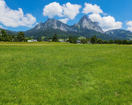 A summertime view in the Swiss canton of Schwyz with the Kleiner Mythen and Grosser Mythen summits in the background.