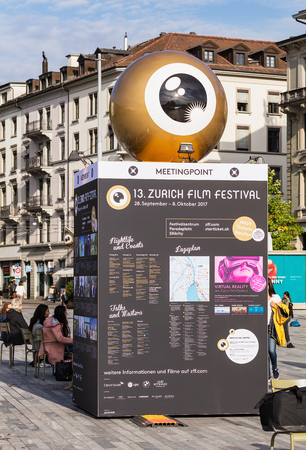 Zurich, Switzerland - September 29, 2017: people at the meeting point stand of Zurich Film Festival on Sechselautenplatz square. Zurich Film Festival takes place annually at the end of September since 2005, in 2017 it lasted from 28 September till 8 Octob