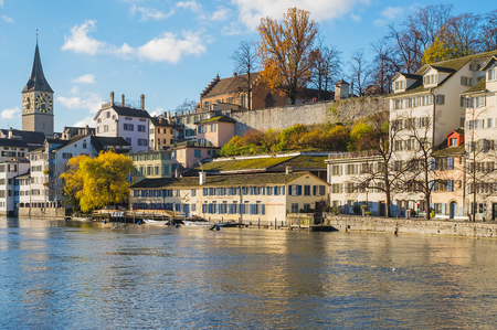 Zurich, Switzerland - November 25, 2013: the Limmat river, buildings of the historic part of the city of Zurich along it. Zurich is the largest city in Switzerland and the capital of the Swiss canton of Zurich.