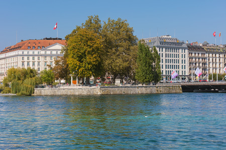 Geneva, Switzerland - September 24, 2016: the Rhone river and buildings of the city of Geneva along it. The city of Geneva is the capital of the Swiss canton of Geneva, it is the second most populous city in Switzerland.