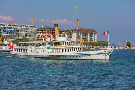 Geneva, Switzerland - September 24, 2016: the Savoie ship passing on Lake Geneva, view from the city of Geneva. The Savoie was built in 1914 and restored to its former Belle Epoque splendour in 2006, it is used for cruises on Lake Geneva.