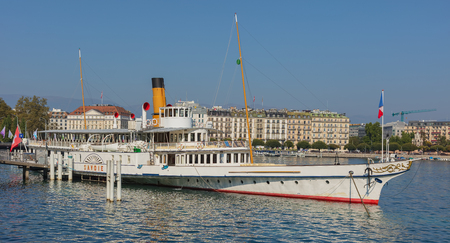 Geneva, Switzerland - September 24, 2016: the Savoie ship at a pier on Lake Geneva in the city of Geneva. The Savoie was built in 1914 and restored to its former Belle Epoque splendour in 2006, it is used for cruises on Lake Geneva.