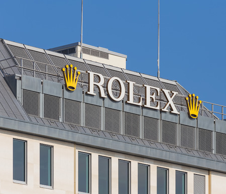 Geneva, Switzerland - September 24, 2016: Rolex sign on the roof of a building in the city of Geneva. Rolex SA is a Swiss luxury watchmaker. The company was founded by Hans Wilsdorf and Alfred Davis in London, England in 1905 as Wilsdorf and Davis and mov