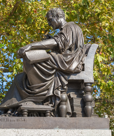 Geneva, Switzerland - September 24, 2016: a statue of Jean-Jacques Rousseau in the city of Geneva. Jean-Jacques Rousseau was a Genevan philosopher, writer and composer. The statue created by sculptor Jean-Jacques Pradier was cast in Paris in 1834 and tran