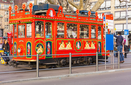 Zurich, Switzerland - December 19, 2016: people at the Marlitram on Bellevue square. The Marlitram is the oldest tram in Zurich, running in the advent season as an attraction for children, with the driver dressed as Santa Claus.