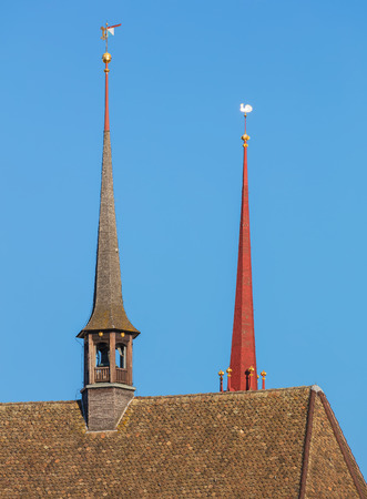 Roof of the Water Church (German: Wasserkirche) in the city of Zurich, steeple of the Grossmunster cathedral behind it.