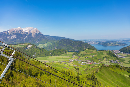 View from the top of the Stanserhorn mountain in the Swiss canton of Nidwalden at the beginning of May,  summit of Mt. Pilatus in the background.
