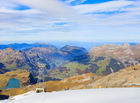 View from Mt. Titlis in Switzerland at the middle of October. The Titlis is a mountain, located on the border between the Swiss cantons of Obwalden and Bern, it is a popular tourist destination mainly accessed from the town of Engelberg.
