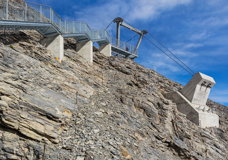 Mt. Titlis, Switzerland - October 12, 2015: a part of the structure of the Titlis Cliff Walk suspension bridge. The Titlis Cliff Walk is a suspension bridge along the cliff of the Titlis, built at about 3,000 m above sea level.