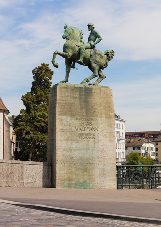 Zurich, Switzerland - May 25, 2016: the monument to Hans Waldmann at the Munsterbruecke bridge in the city of Zurich. Hans Waldmann was a mayor of Zurich and Swiss military leader, the monument created by Swiss sculptor Hermann Haller was unveiled on Apri